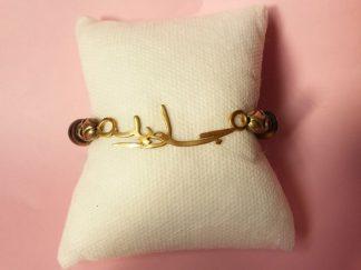 Code 228 دستبند طلا 18 عیار با سنگ چشم ببر